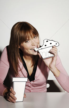 Cardboard cutout : Businesswoman eating cardboard cut-out cake