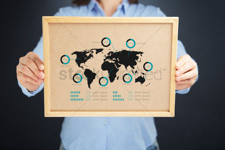 Count : Businesswoman holding a cork board with infographic elements