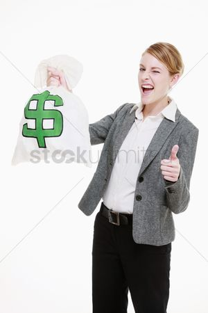 Dollar sign : Businesswoman holding a money bag and showing thumbs up