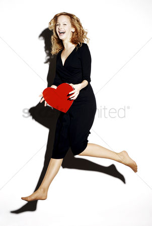 Lively : Businesswoman holding a red heart
