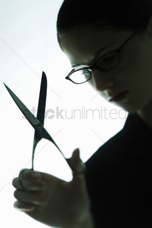 Composed : Businesswoman holding a scissors