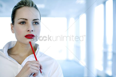 Creativity : Businesswoman in deep thought