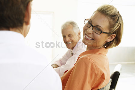 Smile : Businesswoman in meeting