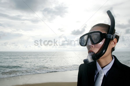 Relaxing : Businesswoman in snorkel standing on the beach