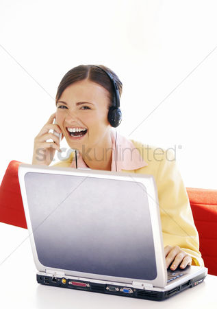 Lively : Businesswoman laughing while talking on the hand phone