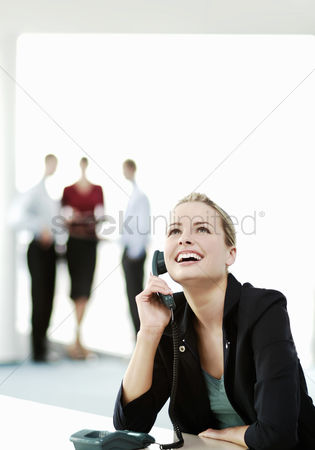 Profession : Businesswoman laughing while talking on the phone