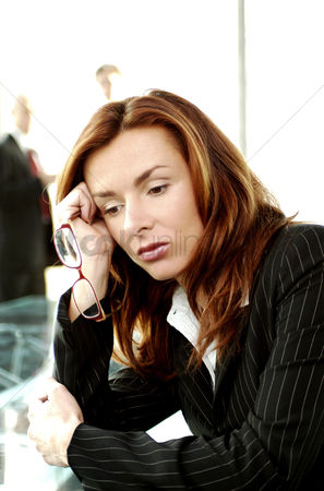 Vision : Businesswoman looking depressed