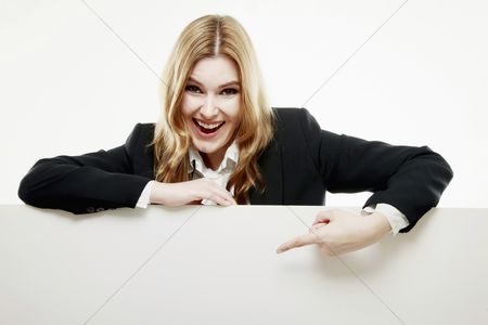 Cardboard cutout : Businesswoman pointing at blank placard