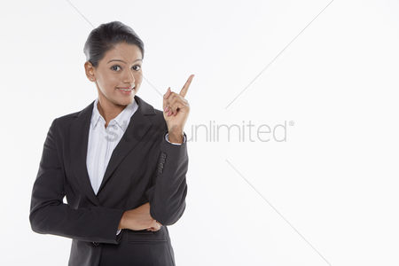 Malaysian indian : Businesswoman pointing upwards