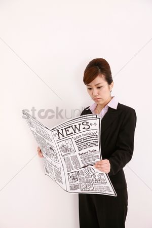 Cardboard cutout : Businesswoman reading newspaper
