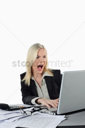 British ethnicity : Businesswoman screaming while using laptop