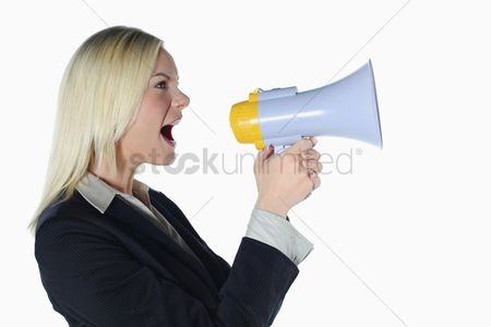 Advice : Businesswoman shouting into megaphone