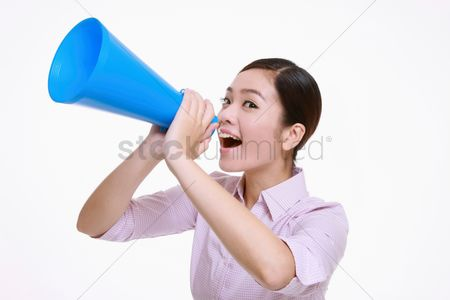 Motivation business : Businesswoman shouting through a megaphone