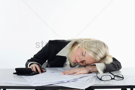 British ethnicity : Businesswoman sleeping at her table