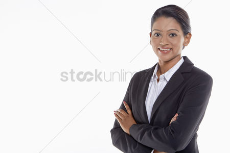 Three quarter length : Businesswoman smiling with arms crossed