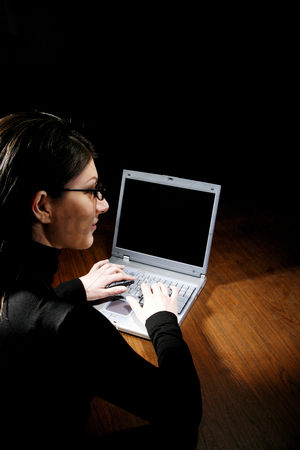Bespectacled : Businesswoman using laptop