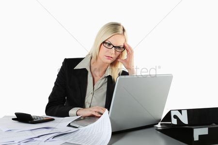 British ethnicity : Businesswoman using laptop