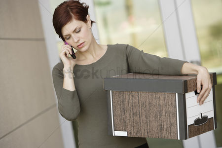 Cellular phone : Businesswoman using mobile phone with moving box
