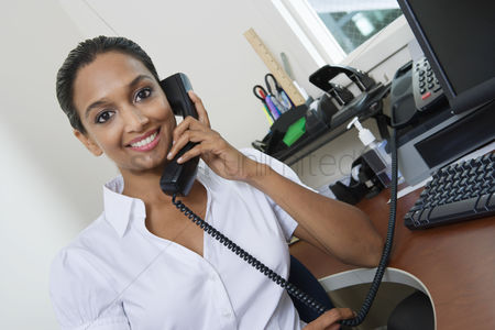 Posed : Businesswoman using telephone