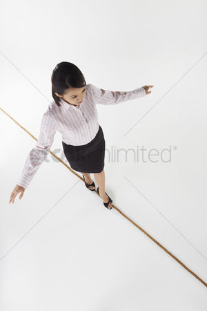 Motivation business : Businesswoman walking on a tightrope