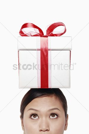 Birthday present : Businesswoman with gift box on top of her head