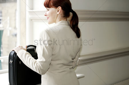 Contemplation : Businesswoman with laptop bag