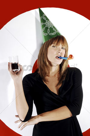 Blowing : Businesswoman with party hat celebrating