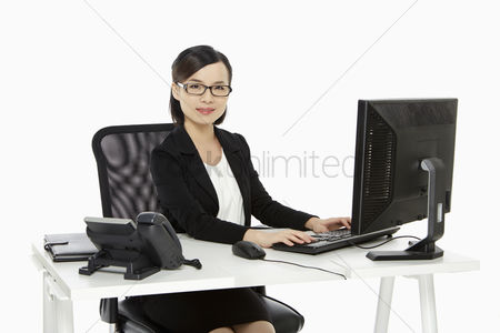 China : Businesswoman working on a computer