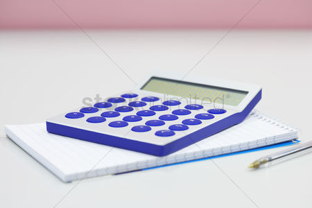 Notepad : Calculator notebook and pen on table close up