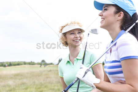 40 44 years : Cheerful female friends at golf course