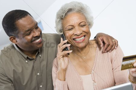 Husband : Cheerful senior couple managing home finances
