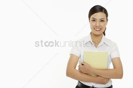 Study : Cheerful woman carrying books