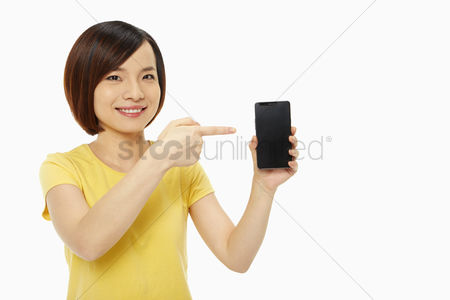 China : Cheerful woman pointing at the mobile phone