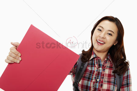 Excited : Cheerful woman showing her good grades