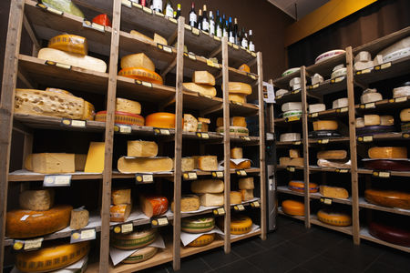 Variety : Cheese arranged in shelves at store