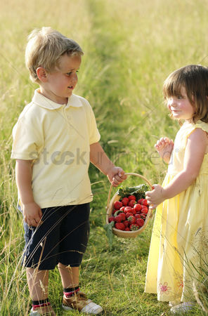 First : Children holding a basket of strawberries