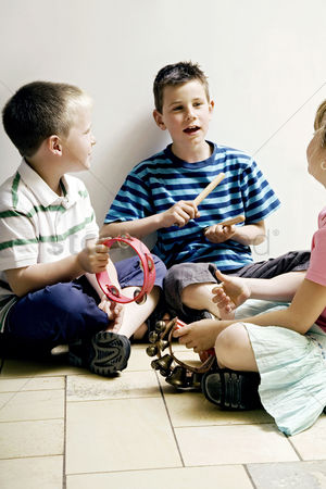 School children : Children playing with musical instrument