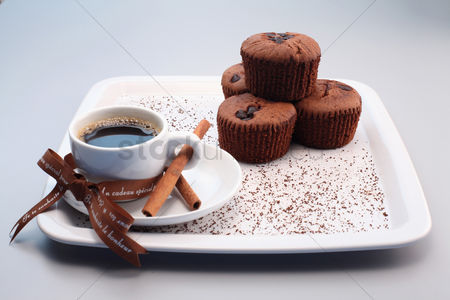 Ready to eat : Chocolate chip muffins with a cup of espresso