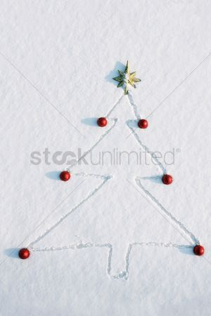China : Christmas tree drawn and decorated in snow