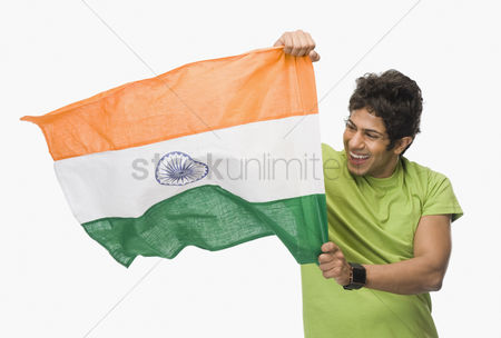 Respect : Close-up of a man holding an indian flag