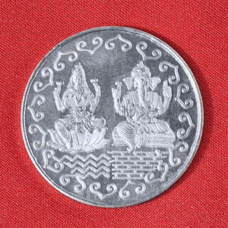 God : Close-up of a silver coin