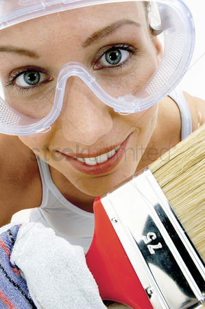 Goggle : Close-up of a woman with goggles holding a brush