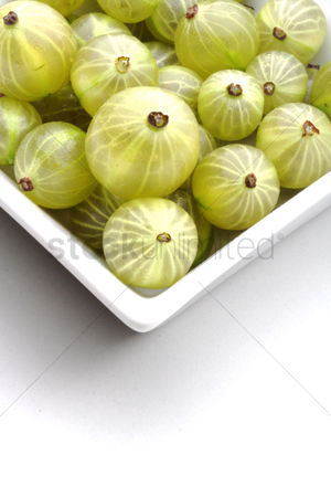 Green grapes : Close up of goosberries on white background