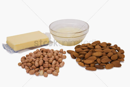 Almond : Close-up of peanuts and almonds with butter and a bowl of noodles