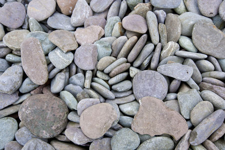 Background : Close up of pebbles at a beach