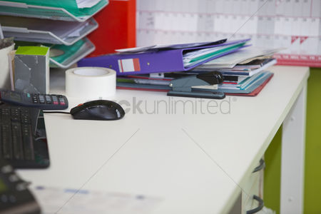 Pile : Close-up of real life messy desk in  office