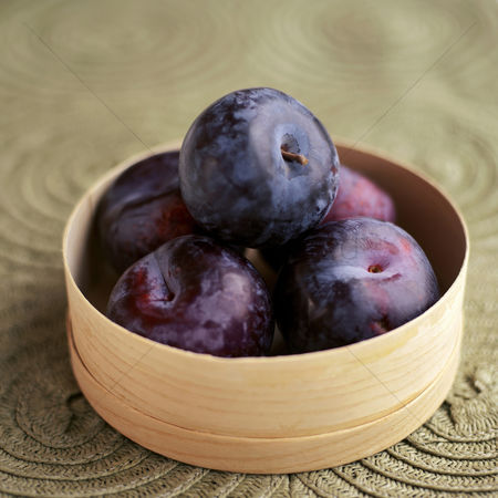 Food  beverage : Close up of some plums in a container