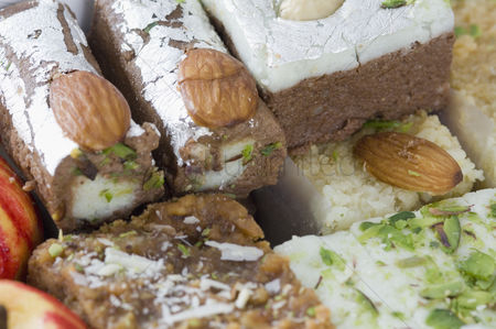 Almond : Close-up of sweets garnished with almonds and pistachio