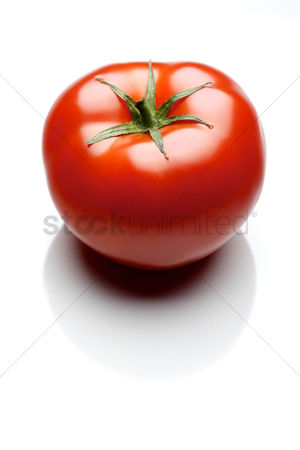 Tasty : Close-up of tomatoes on white background