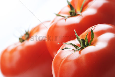 Background : Close-up of tomatoes on white background